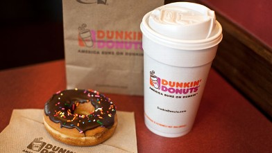 PHOTO: A chocolate glazed donut and a cup of coffee are seen at a Dunkin' Donuts Inc. store in West Orange, New Jersey on July 7, 2011.
