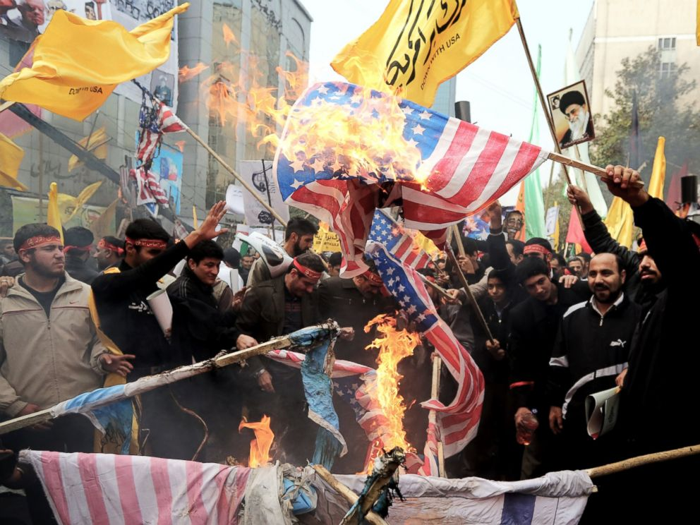 PHOTO: Iranians burn US flags outside the former US embassy in Tehran on Nov. 4, 2013, during a demonstration to mark the 34th anniversary of the 1979 US embassy takeover.