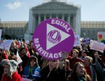 PHOTO: Supporters of same-sex marriage hold signs while demonstrating outside the U.S. Supreme Court in Washington, D.C., March 26, 2013.
