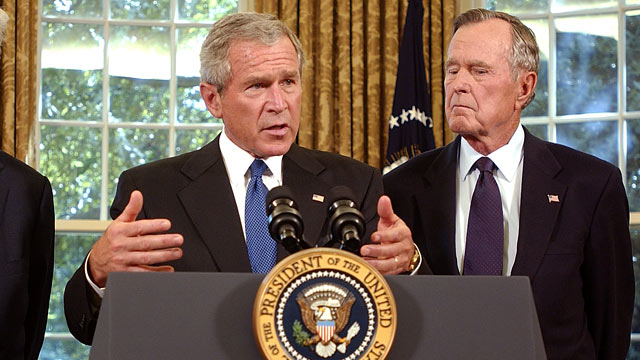 PHOTO: George W. Bush, left, announces that he appointed George H. W. Bush to lead a fund-raising effort for victims of Hurricane Katrina at the White House.