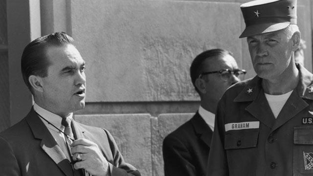 PHOTO: Segregationist Alabama Governor George C. Wallace blocks the doorway to the University of Alabama while talking to Brigadier General Henry Graham of the Alabama National Guard, Tuscaloosa, Ala., June 11, 1963.