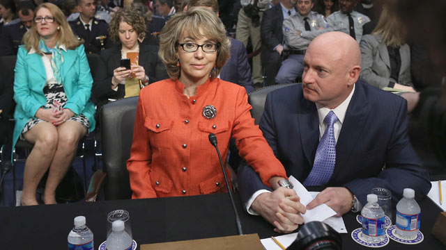 PHOTO: Retired NASA astronaut and Navy Capt. Mark Kelly and his wife, shooting victim and former U.S. Rep. Gabby Giffords, D-Ariz., prepares to give an opening statement before the Senate Judiciary Committee during hearing about gun control on Capitol Hil