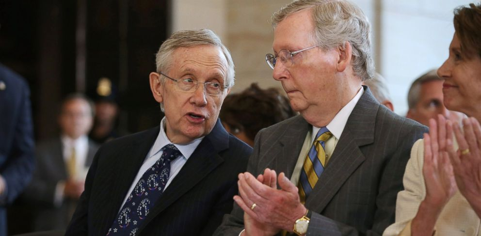 PHOTO: Senate Majority Leader Harry Reid, D-Nev., left, and Senate Minority Leader Mitch McConnell, R-Ky., attend a ceremony honoring former South African President Nelson Mandela on Capitol Hill, July 18, 2013, in Washington.