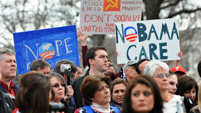 PHOTO: Participants display placards during a demonstration in Washington, DC, March 16, 2010 in opposition to the health care reform bill.