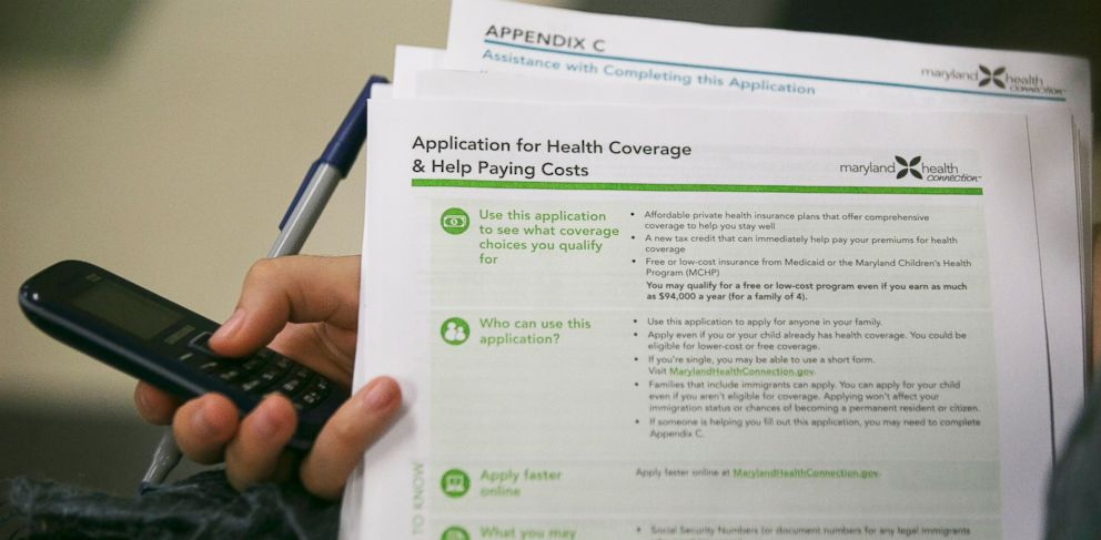 PHOTO: Health navigator Rebecca Wener holds a Maryland Health Connection health insurance marketplace written application at a Community Clinic Inc. health center in Takoma Park, Maryland, U.S., on Oct. 1, 2013.