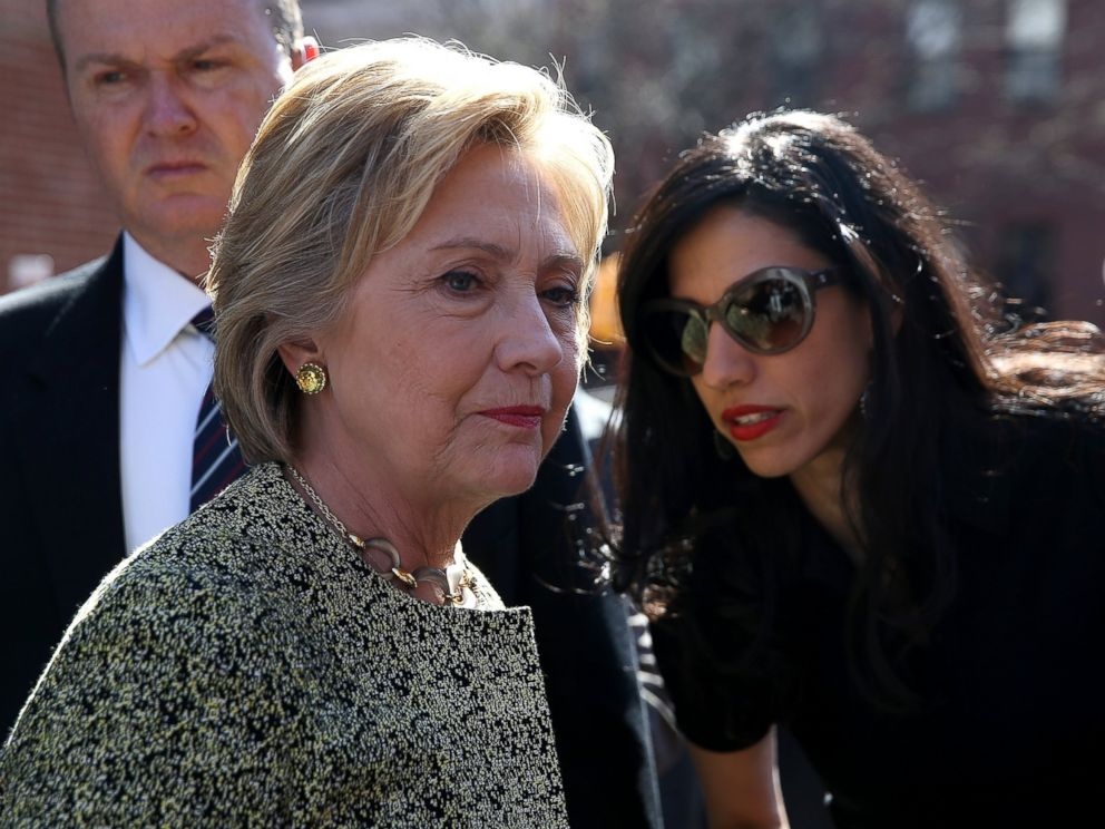 PHOTO: Democratic presidential candidate Hillary Clinton talks with aide Huma Abedin before speaking at a neighborhood block party in the Brooklyn borough of New York City, April 17, 2016.