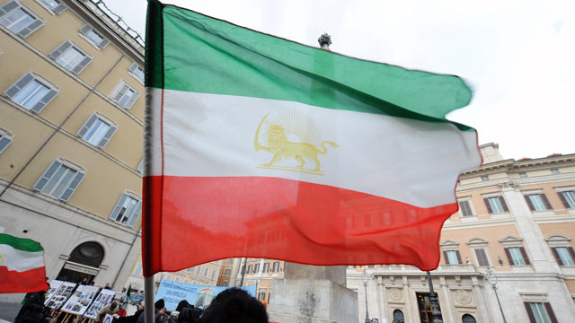 PHOTO: A demonstrator waves an Iranian flag during a demonstration against the Iranian regime in front of the Italian parliament, Rome, Italy, Feb. 11, 2010.