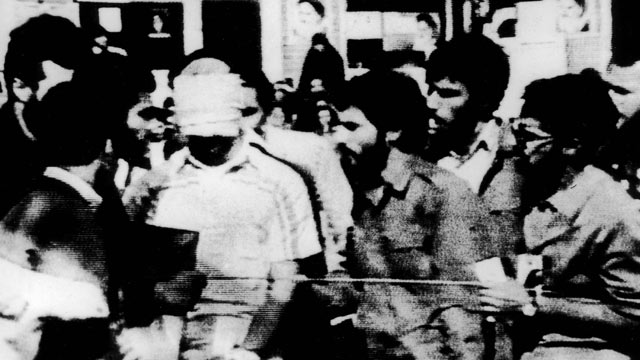 PHOTO: An U.S. hostage is paraded by his captors in the compound of the US Embassy Tehran, Iran on Nov. 8, 1979.
