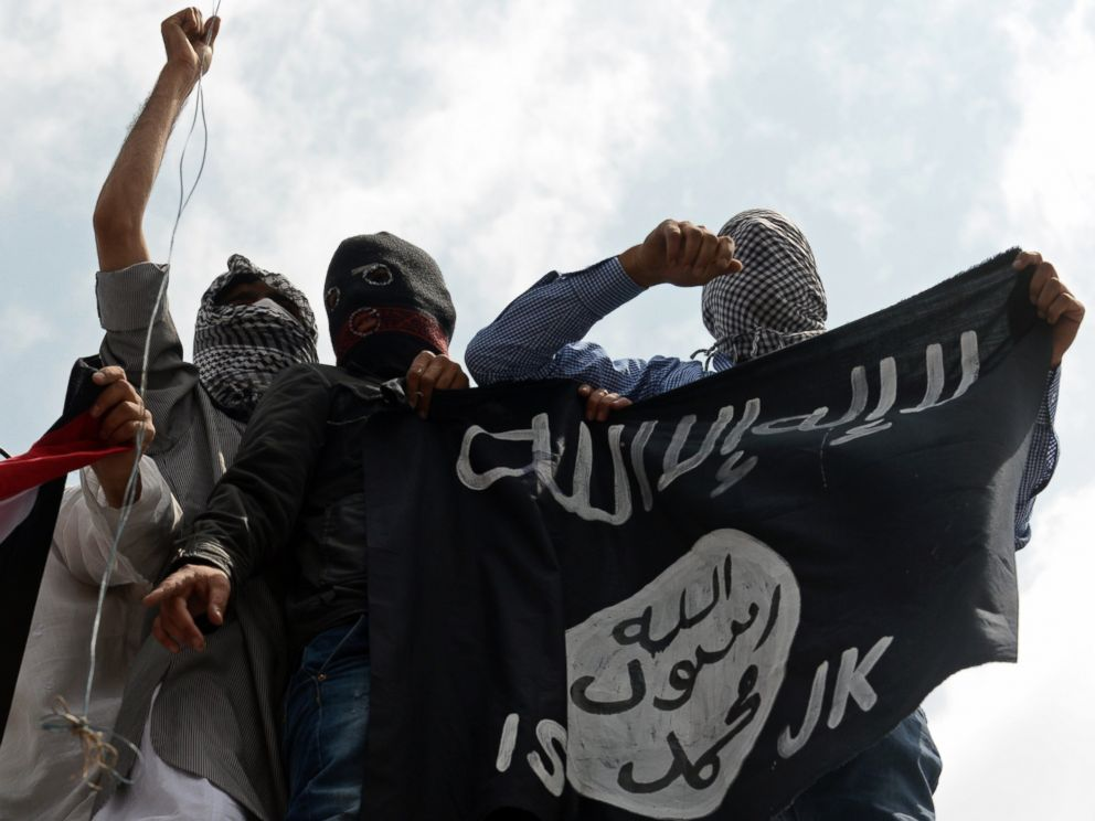 PHOTO: Kashmiri demonstrators hold up a flag of the Islamic State of Iraq and the Levant (ISIL) during a demonstration against Israeli military operations in Gaza, in downtown Srinagar, July 18, 2014.
