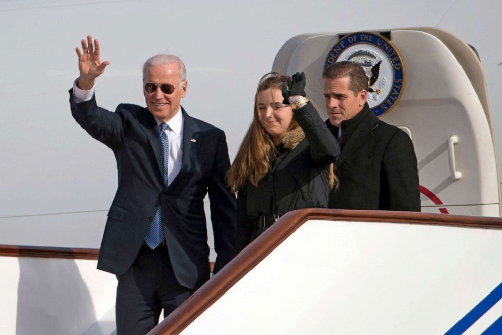 PHOTO: Vice President Joe Biden waves as he walks out of Air Force Two with his granddaughter Finnegan Biden and son Hunter Biden at the Beijing airport on Dec. 4, 2013.