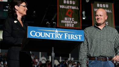 """PHOTO: Joe Wurzelbacher looks on as Sarah Palin speaks October 29, 2008 at Bowling Green University in Bowling Green, Ohio. Joe Wurzelbacher, also known as """"Joe the plumber"""" of Holland, Ohio, campaigned with Palin for the first time at the event."""