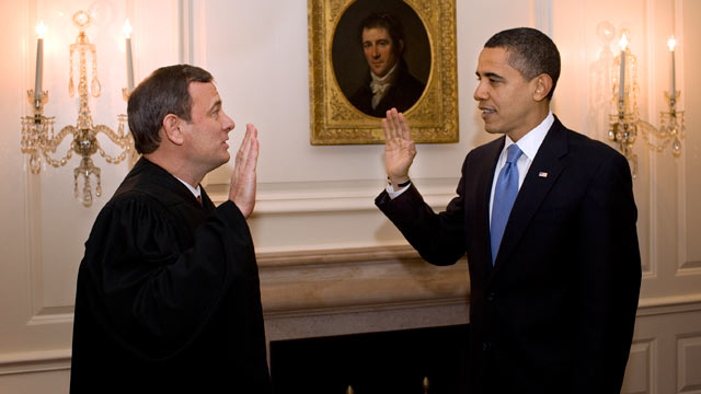 PHOTO: Chief Justice John G. Roberts Jr. administers the oath of office to President Barack Obama in the Map Room of the White House on Jan. 21, 2009.