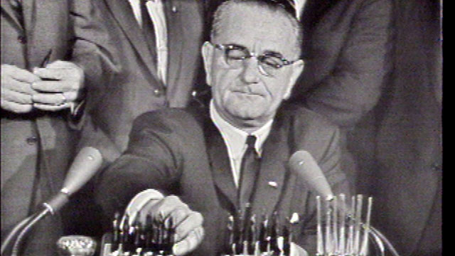 PHOTO: President Lyndon B. Johnson signs the Civil Rights Act of 1964, Washington, D.C., July 2, 1964.