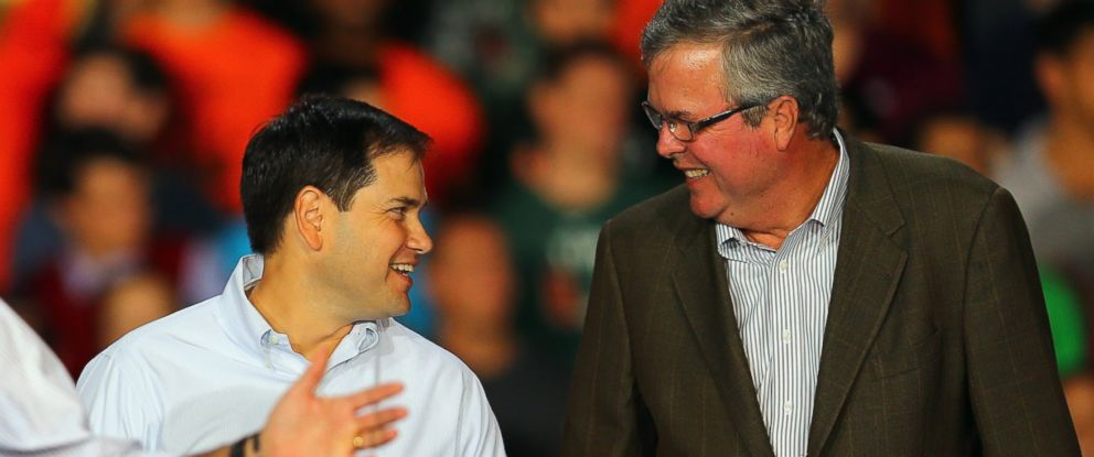 PHOTO: Marco Rubio and Jeb Bush attend a campaign rally for Mitt Romney at the University of Miami on Oct. 31, 2012 in Miami.