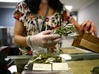PHOTO: Sales associate, Crystal Guess packages up a patients cannabis inside a Good Meds medical cannabis center in Lakewood, Colorado, U.S., in this March 4, 2013 file photo.