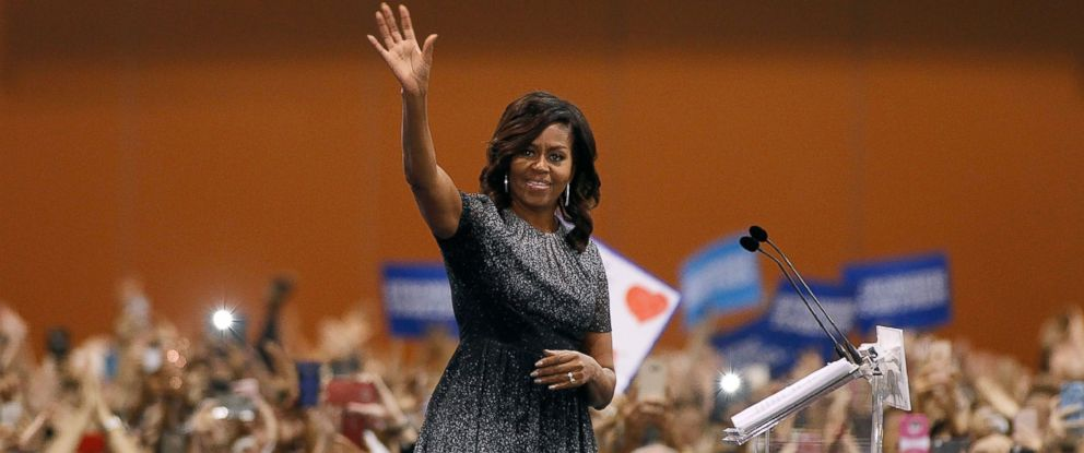 PHOTO: Michelle Obama waves to the crowd as she speaks at an Arizona Democratic Party Early Vote rally in support of Democratic presidential nominee Hillary Clinton, Oct. 20, 2016, in Phoenix, Arizona.