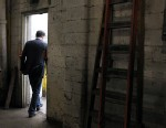 PHOTO: Republican presidential candidate, former Massachusetts Gov. Mitt Romney walks out of a door after he toured a manufacturing facility following a campaign rally at American Posts on February 29, 2012 in Toledo, Ohio.