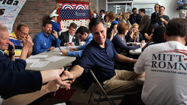 PHOTO: Republican presidential candidate and former Massachusetts Gov. Mitt Romney works the phones for votes at his campaign headquarters, Jan. 31, 2012 in Tampa, Florida.