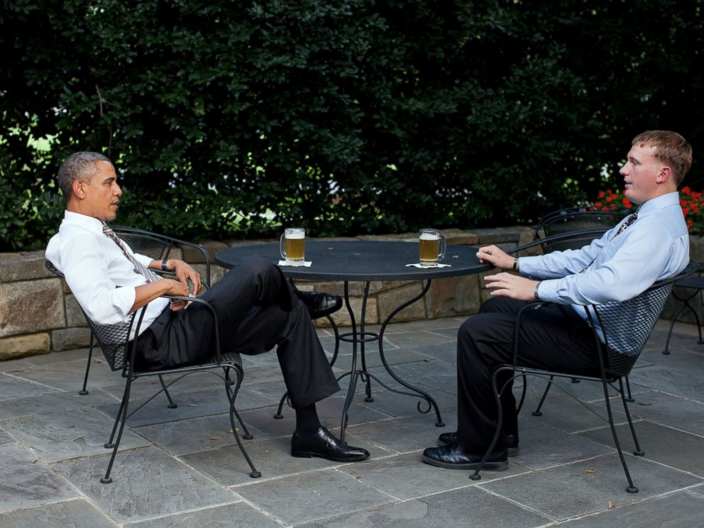 PHOTO: In this handout provided by the White House, U.S. President Barack Obama (L) enjoys a beer with Dakota Meyer on the patio outside of the Oval Office, Sept. 14, 2011 in Washington.