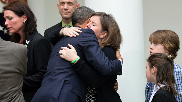 PHOTO: President Barack Obama embraces family members of Newtown school shooting victims, during a press conference at the Rose Garden of the White House in Washington, DC, April 17, 2013.