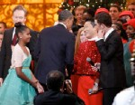 """PHOTO: President Barack Obama shakes hands with South Korean musician PSY, center, with Conan OBrien and performer Scotty McCreery, during the """"Christmas in Washington"""" concert at the National Building Museum on Dec. 9, 2012, in Washington."""