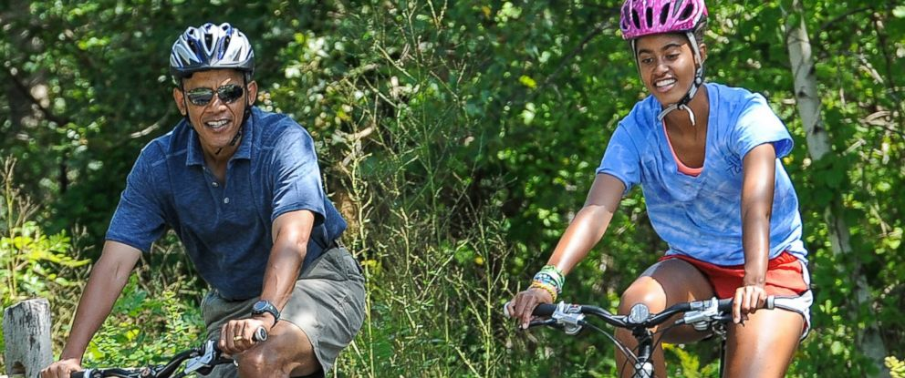 PHOTO: President Barack Obama and his daughter Malia ride bikes during a vacation on Marthas Vineyard on August 16, 2013 in West Tisbury, Mass.