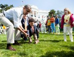 PHOTO: US President Barack Obama helps a young participant during during the 134th annual Easter Egg Roll on the South Lawn of the White House April 9, 2012 in Washington, DC.