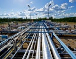 PHOTO: Steam injection pipes, left, and pipes carrying recovered bitumen are seen at Devon Energy Corp.s 35,000 barrel per day Jackfish Projects processing plant, where Steam Assisted Gravity Drainage (SAGD) is used to extract bitumen from oil sands, nea