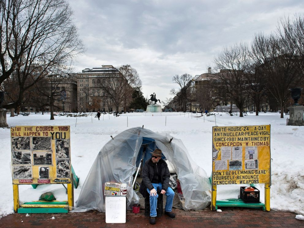 PHOTO: An activist sits at a protest sight in Lafayette Park across from the White House, Jan. 26, 2016 in Washington, DC.