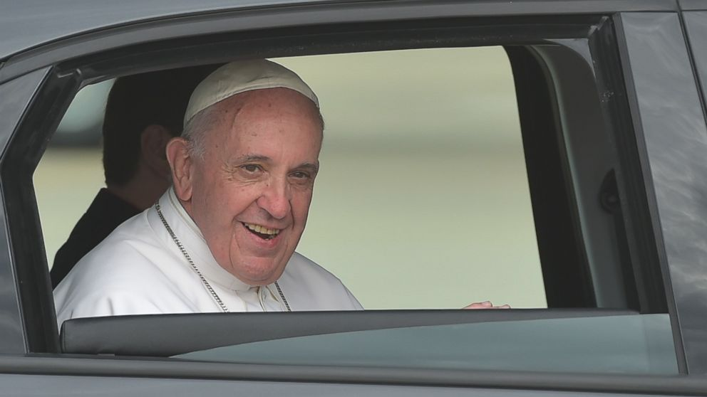 Pope Francis looks out of the window of his automobile after after his arrival at Andrews Air Force Base in Maryland on Sept. 22, 2015.