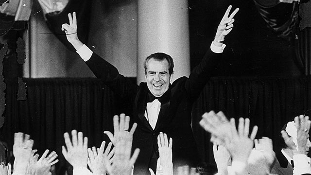 PHOTO: President Richard Nixon gives a double V-sign during the Inaugural Ball to celebrate his election to a second term, Jan. 26, 1973.