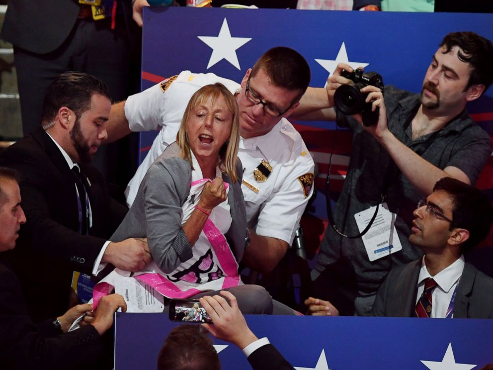 PHOTO: A CODEPINK protester is removed while Republican presidential candidate Donald Trump speaks on the last night of the Republican National Convention on July 21, 2016, in Cleveland.