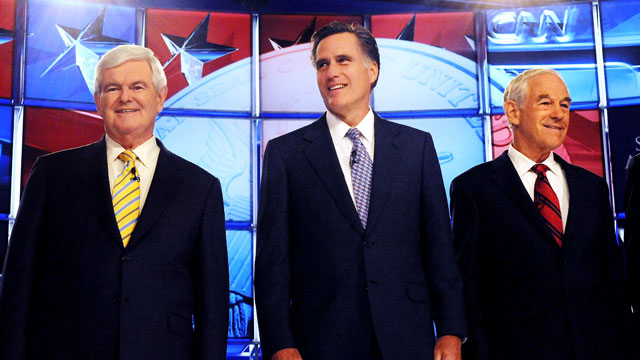 PHOTO: Republican candidates former House Speaker Newt Gingrich, former Governor Mitt Romney and U.S. Rep. Ron Paul participate in a debate, June 13, 2011 in Manchester, New Hampshire.