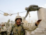 PHOTO: U.S. Marines pull down a statue of Saddam Hussein in the centre of Baghdad on April 9, 2013.