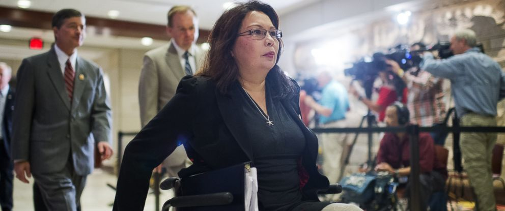 PHOTO: Rep. Tammy Duckworth, D-Ill., makes her way to a closed briefing in the Capitol Visitor Center for House members on the administrations strategy for combating ISIL, in this Sept. 11, 2014 file photo.