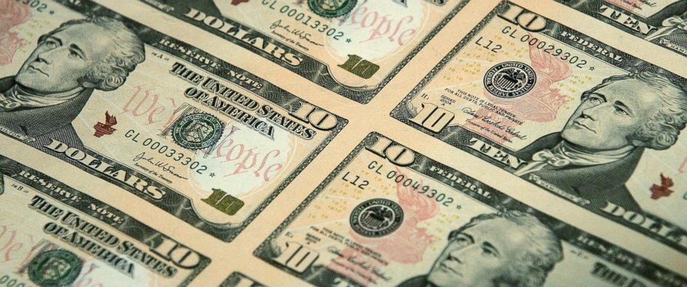 PHOTO: An uncut sheet of the redesigned $10 bill is seen after a news conference to commemorate the first day of circulation of the new notes at the National Archives March 2, 2006 in Washington.