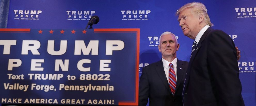 PHOTO: Mike Pence (L) welcomes Donald Trump to the stage during a campaign event about the Affordable Care Act at the DoubleTree by Hilton Nov. 1, 2016 in King of Prussia, Pennsylvania.