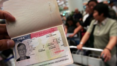 PHOTO: A U.S. visa is shown by a tourist in Beijing, China.