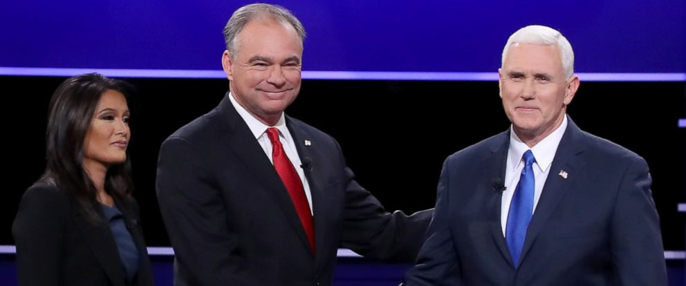 PHOTO: Vice presidential nominees Tim Kaine and Mike Pence shake hands on stage as debate moderator Elaine Quijano looks on prior to the Vice Presidential Debate at Longwood University on Oct. 4, 2016 in Farmville, Virginia.