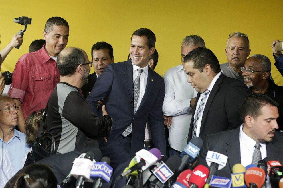 driving  street PHOTO: Venezuelan opposition leader Juan Guaido greets supporters during a press conference at the headquarters of political party Un Nuevo Tiempo on May 03, 2019, in Caracas, Venezuela.