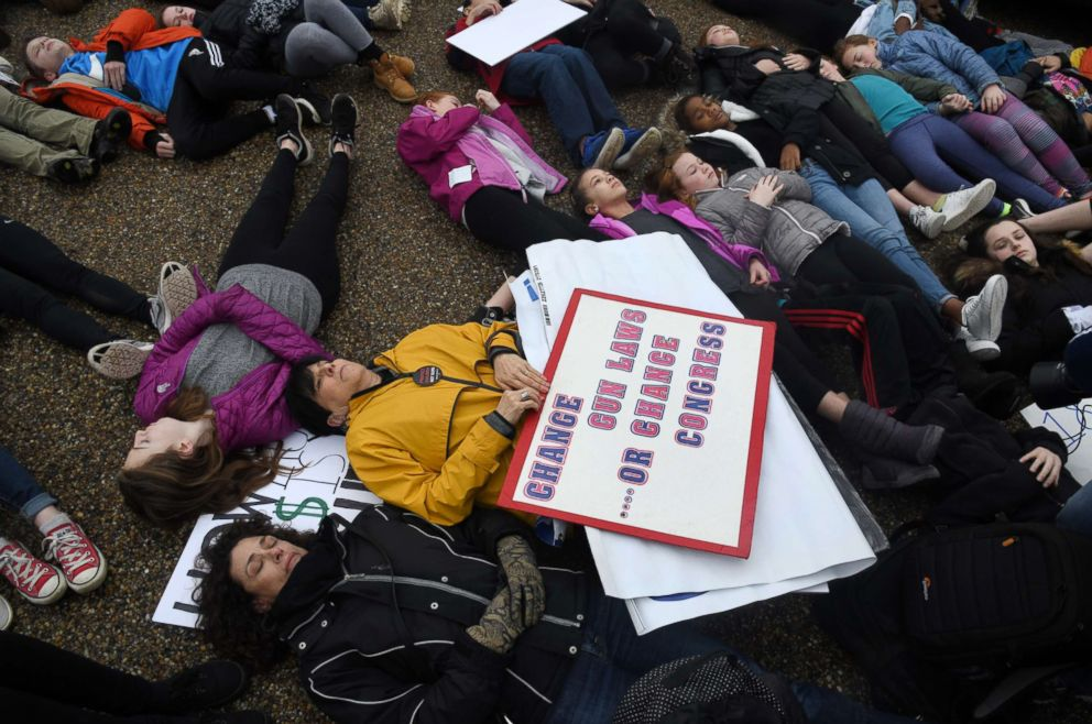 PHOTO: Students take part in a lie-in on the road outside of the White House, Feb. 19, 2018 in Washington, D.C.