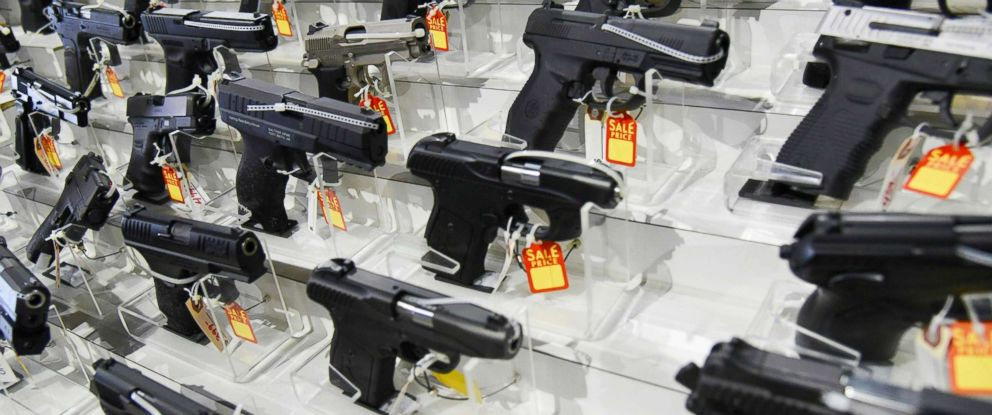 PHOTO: Guns lie in a booth during preparations for a gun show on Feb. 16, 2018, at the Dade County Youth Fairgrounds Fairgrounds in Miami.