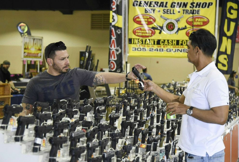 PHOTO: Preparations are underway on Feb. 16, 2018, for the South Florida Gun Show at Dade County Youth Fairgrounds in Miami. Florida. <p itemprop=