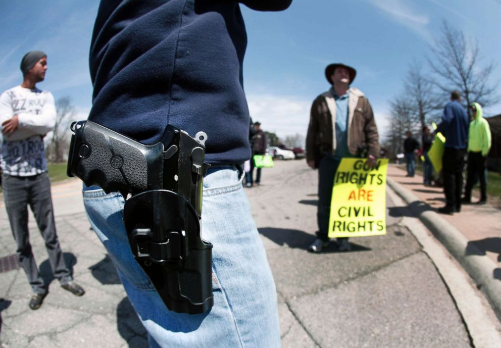 PHOTO: A supporter of Michigans Open Carry law attends a rally and march, April 27, 2014, in Romulus, Mich.