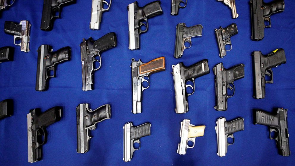 PHOTO: Seized handguns are pictured at the police headquarters in New York City, Aug. 19, 2013.
