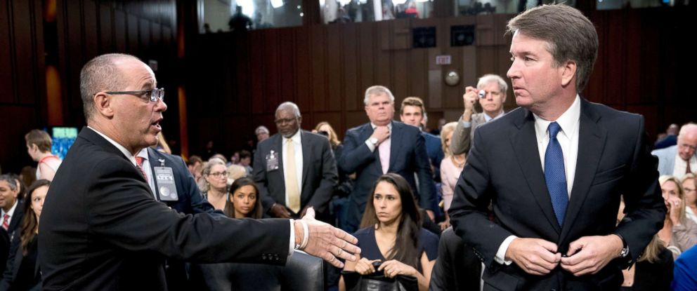 PHOTO: Fred Guttenberg, left, attempts to shake hands with President Donald Trumps Supreme Court nominee, Brett Kavanaugh as he leaves for a lunch break while appearing before the Senate Judiciary Committee on Capitol Hill in Washington, Sept. 4, 2018.