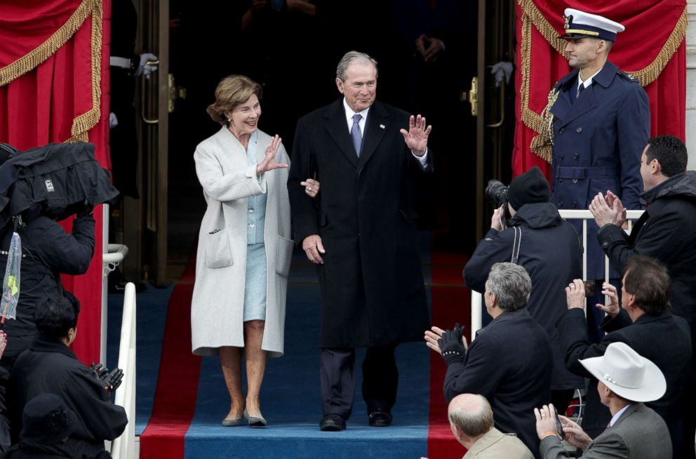 PHOTO: Former President George W. Bush and Laura Bush wave as they arrive for the inauguration of President Trump at the Capitol, Jan. 20, 2017 in Washington, D.C.