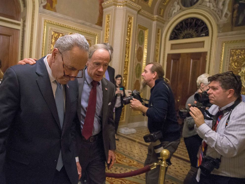 PHOTO: WASHINGTON, DC - JANUARY 19: (L-R) Senate Minority Leader Chuck Schumer (D-NY) and Senator Tom Carper (D-DE) walk out of a Democratic Caucus meeting at the US Capitol on January 19, 2018 in Washington, DC.