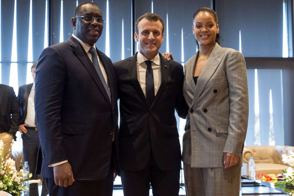 PHOTO: (L-R) Senegalese President Macky Sall, Barbadian singer Rihanna and French President Emmanuel Macron pose a they attend the conference GPE Financing Conference, an Investment in the Future in Dakar on February 2, 2018.