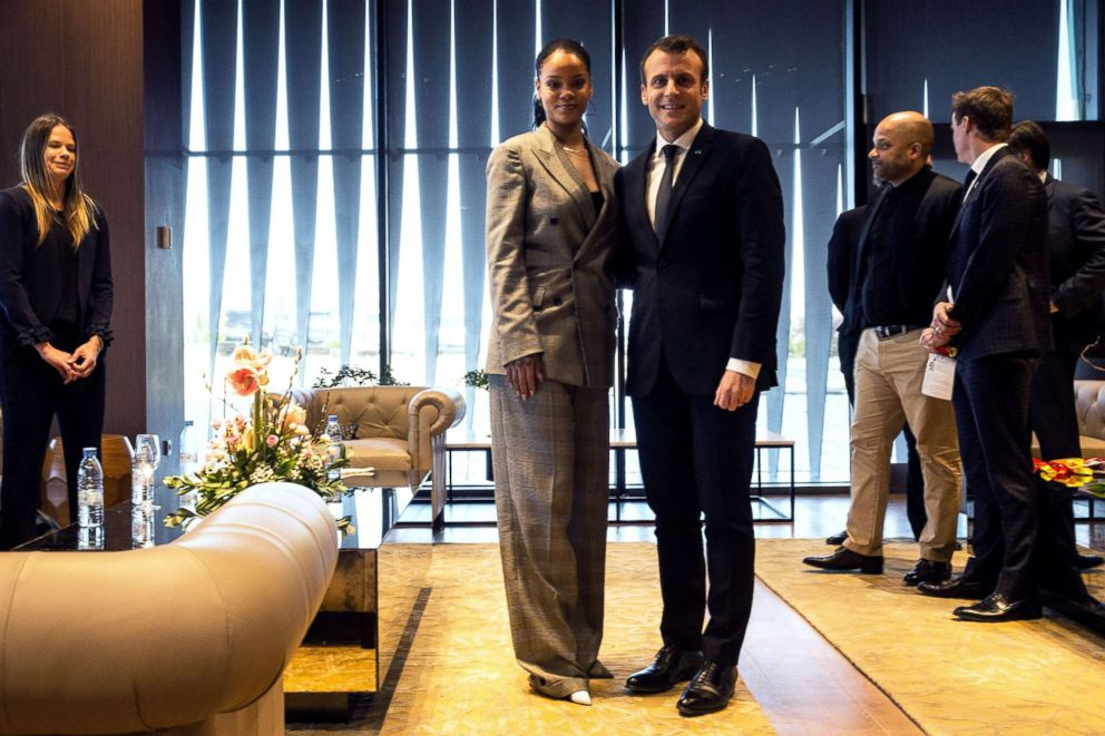 PHOTO: Barbadian singer Rihanna (L) and French President Emmanuel Macron pose a they attend the conference GPE Financing Conference, an Investment in the Future organised by the Global Partnership for Education in Dakar on February 2, 2018.